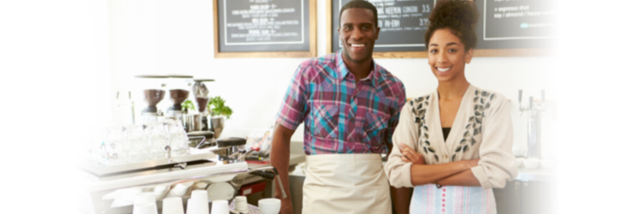 Smiling woman and man coffee shop business owners
